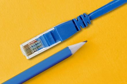 Pencil and LAN cable on yellow background