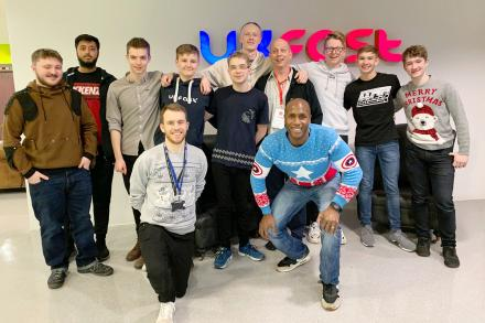 Tom Robinson and Aaron Saxton with G. Matthew Rice and a group of apprentices